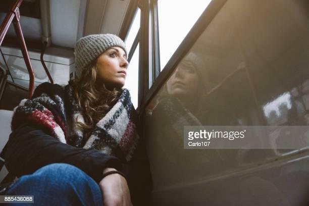 Young sad woman on a bus