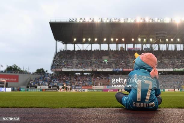 A young Sagan Tosu supporter watches players' warm up prior to the JLeague J1 match between Sagan Tosu and Urawa Red Diamonds at Best Amenity Stadium...