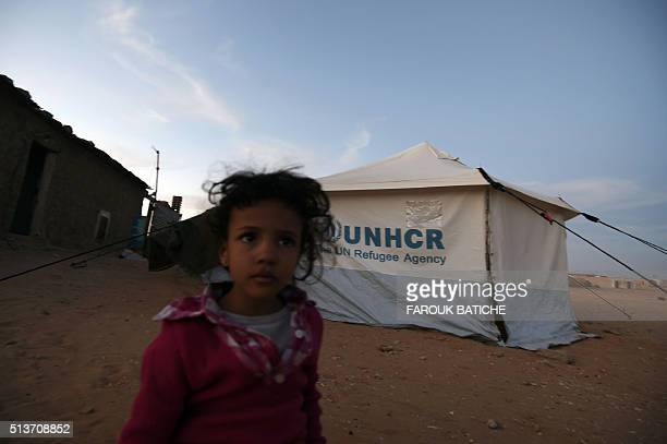 A young Sahrawi refugee stands next to a tent at the Boujdour refugee camp near the Algerian city of Tindouf in the disputed territory of Western...
