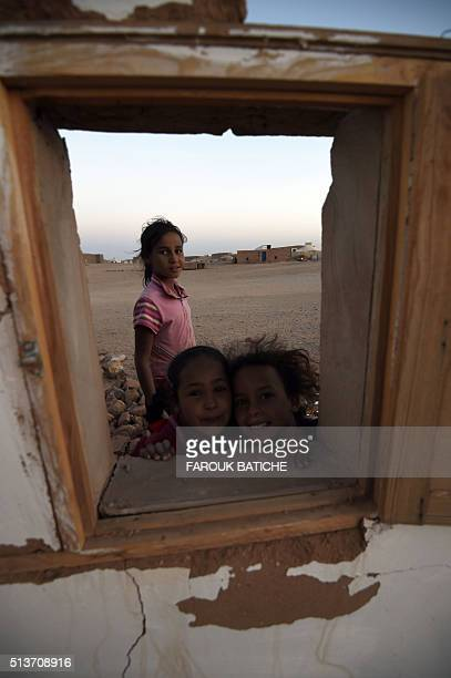 Young Sahrawi refugees stand on the rubble of a house which was destroyed during heavy rain last year at the Boujdour refugee camp near the Algerian...