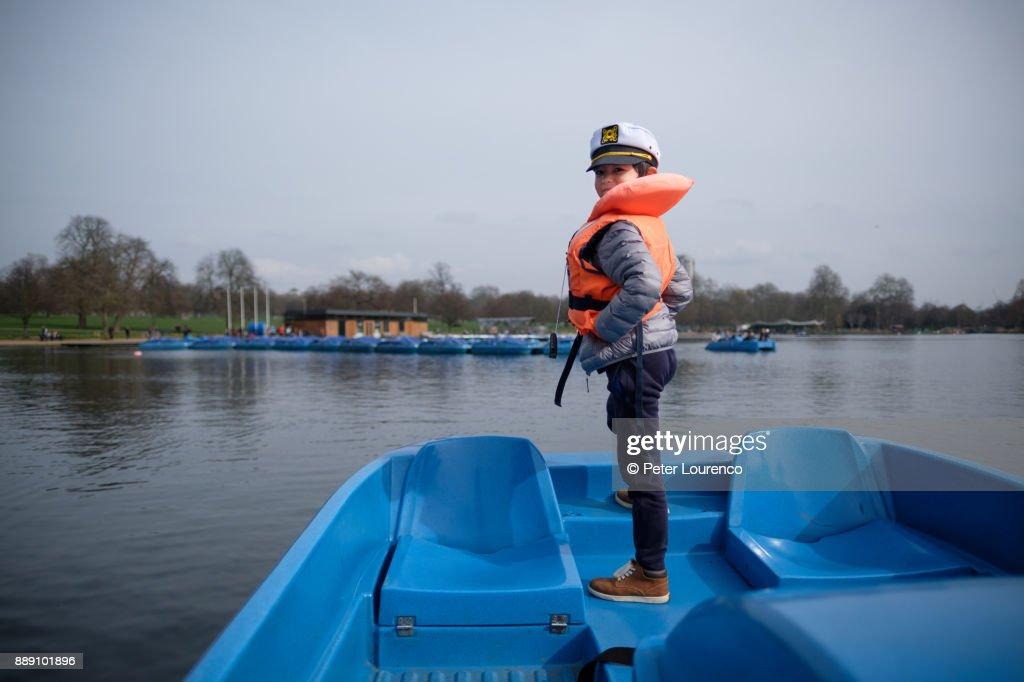 Young sailor standing at prow of boat : Stock Photo