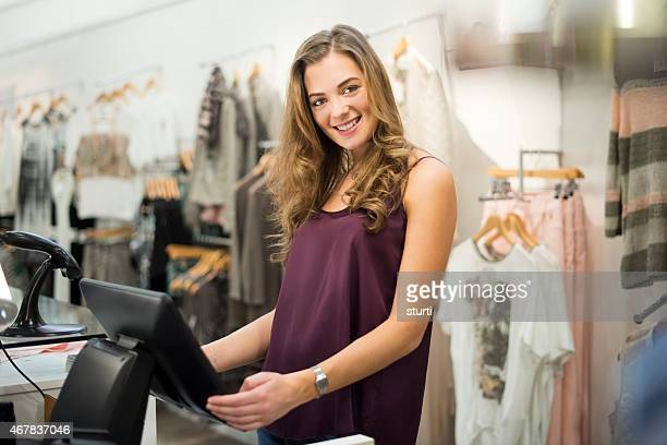 young sales assistant smiling to camera