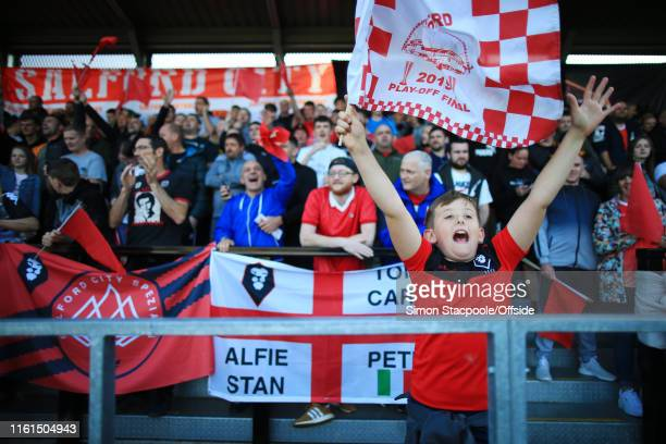 A young Salford fan cheers on his team during the Carabao Cup First Round match between Salford City and Leeds United at Moor Lane on August 13 2019...