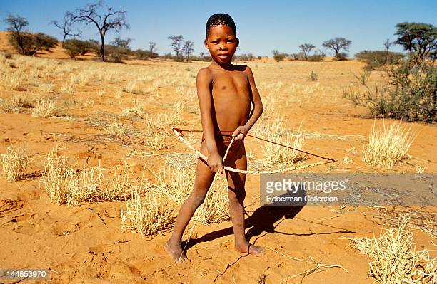 Young San Boy with Bow and Arrow