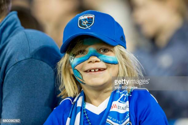 A young San Jose Earthquakes fan cheers on her team during the Major League Soccer game between the Portland Timbers and the San Jose Earthquakes at...