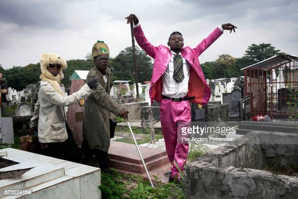 Young Sapeurs parade and show their designer label clothes while paying their respect to Stervos Nyarcos, the founder of the .kitendi religion.,...