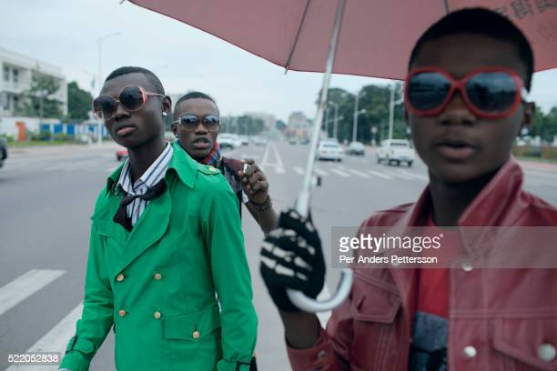 Young Sapeurs show their designer label clothes while parading on Boulevard 30 Juin while paying their respect to Stervos Nyarcos the founder of the...