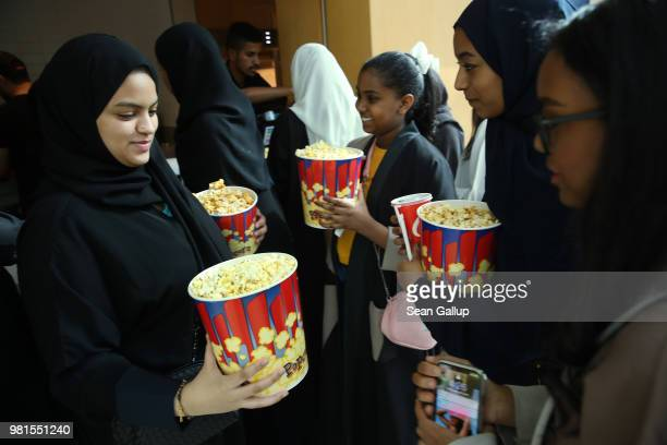 Young Saudi female teenage friends purchase popcorn during their first outing ever to a cinema in Saudi Arabia to watch 'The Incredibles 2' at the...