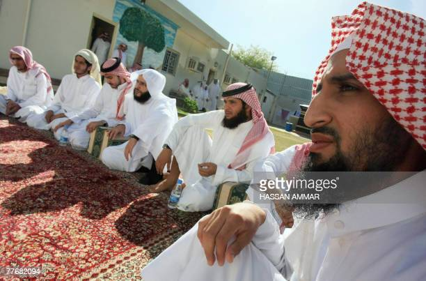 Young Saudi men released from the US Guantanamo Bay detentioncentre as well as prisons in Iraq and Saudi Arabia listen to a Muslim cleric during a...