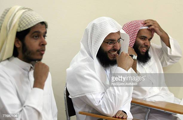 Young Saudi men released from the US Guantanamo Bay detentioncentre as well as prisons in Iraq and Saudi Arabia share a light moment at an interior...