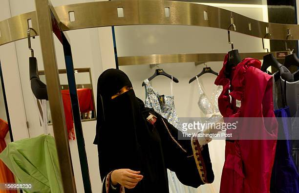 A young Saudi woman in her 20's shops for dresses on the women only level at Kingdom Centre Mall in Riyadh Saudi Arabia on October 2 2012 On the...