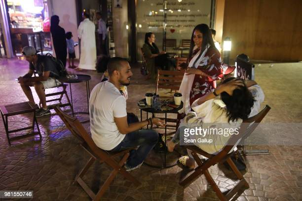 Young Saudis chat outside Medd Cafe and Roastery a popular hangout where Saudi men and women mix together freely on June 21 2018 in Jeddah Saudi...