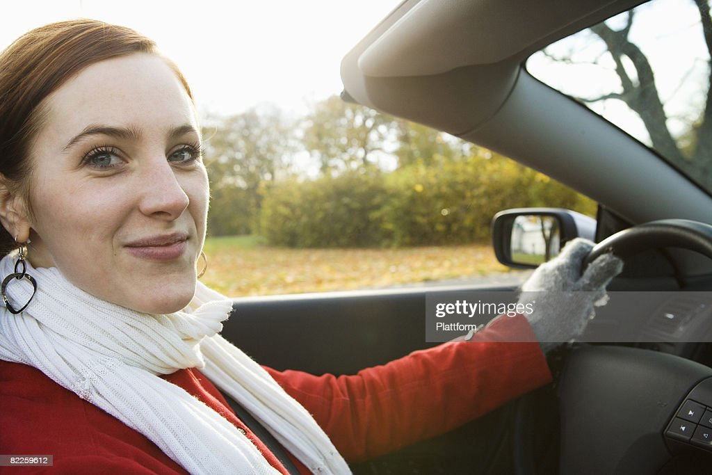 A young Scandinavian woman in a cabriolet Sweden. : Stock Photo