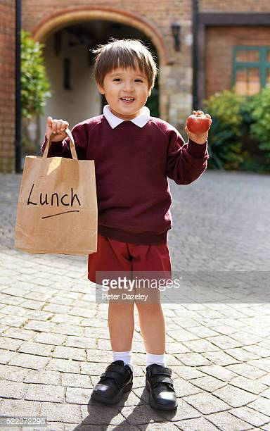 young school boy with lunch - schoolboy stock pictures, royalty-free photos & images
