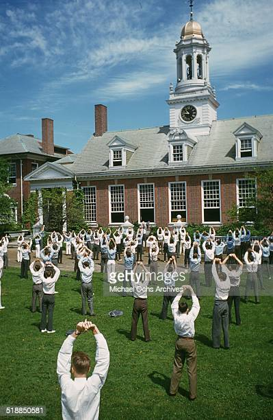 Young school boys do calisthenics during physical education in school in GrotonMassachusetts