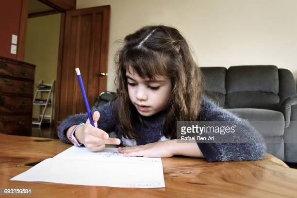 Young school girl doing homework