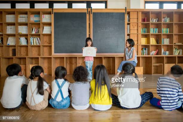 young school girl giving a presentation in class - speech stock pictures, royalty-free photos & images