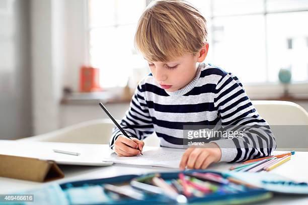Young schoolboy doing his homework