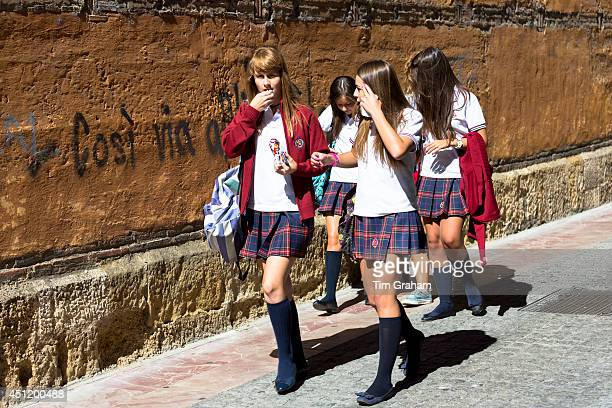 Young schoolchildren students strolling in Calle Sacramento in Leon Castilla y Leon Spain