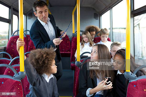 Young Schoolchildren Using Technology on Bus
