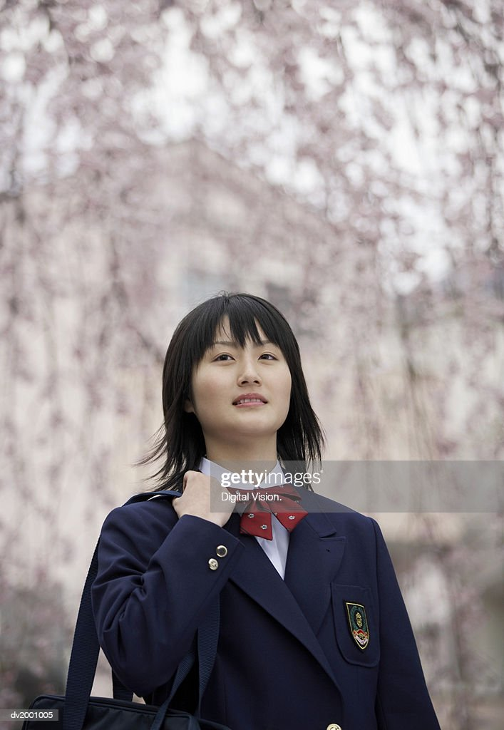 Young Schoolgirl Carrying a Satchel : Stock Photo