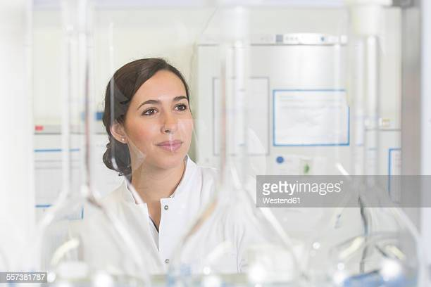Young scientist in laboratory, portrait