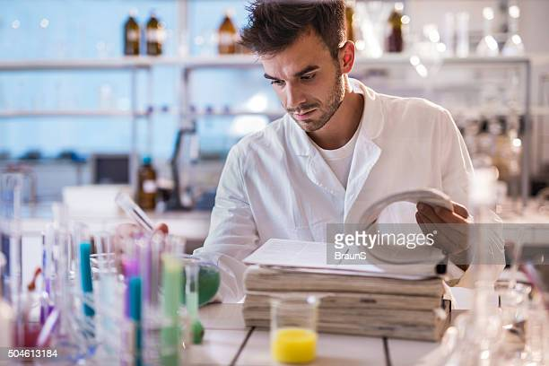 Young scientist reading scientific data in a laboratory.