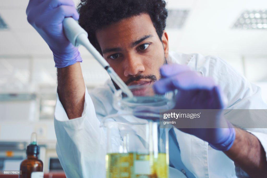 Young scientist working in laboratory : Stock Photo