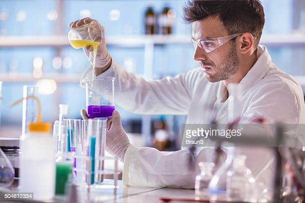 young scientist working on scientific experiment with chemical substances. - mixing stock pictures, royalty-free photos & images