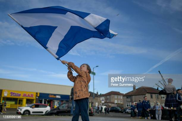 Young Scotland fan is seen waving a saltire outside Hampden on June 18, 2021 in Glasgow, Scotland. Scotland play Croatia hoping to progress from the...