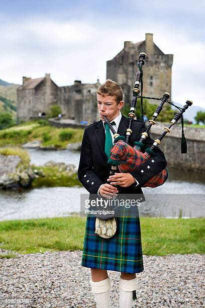 young scottish bagpiper