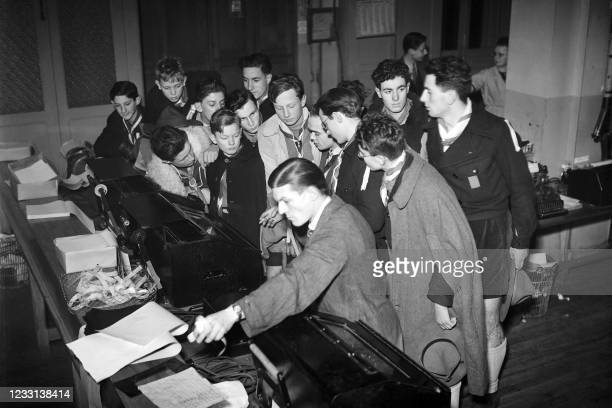 Young scouts visit the Agence France Presse headquarters in Paris in December 1946.