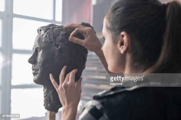 young sculptor creates a clay sculpture - sculptor stock pictures, royalty-free photos & images