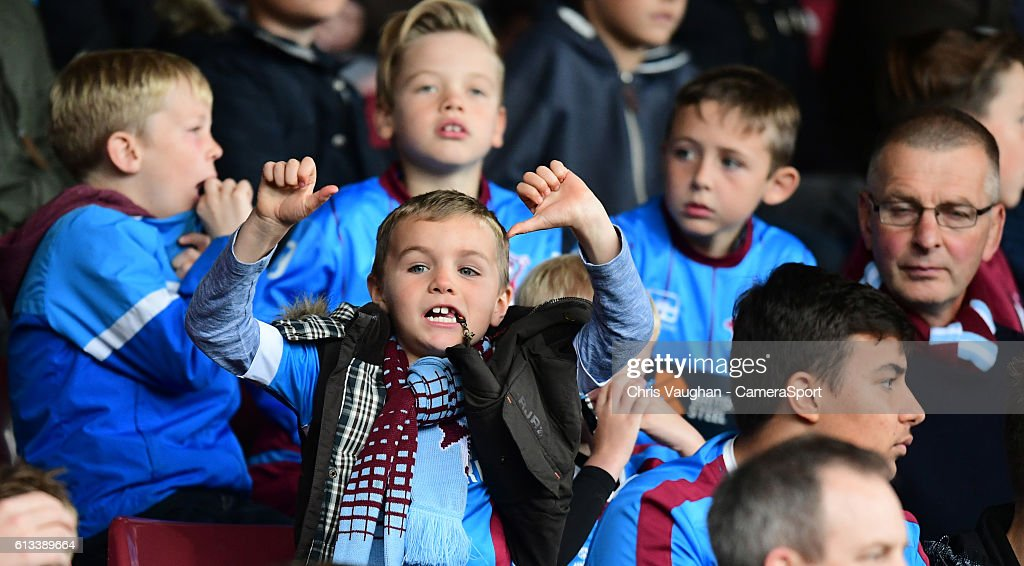 A young Scunthorpe United fan during the Sky Bet League One match between Scunthorpe United and Northampton Town at Glanford Park on October 8, 2016 in Scunthorpe, England.