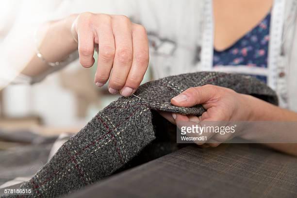 Young seamstress making a jacket
