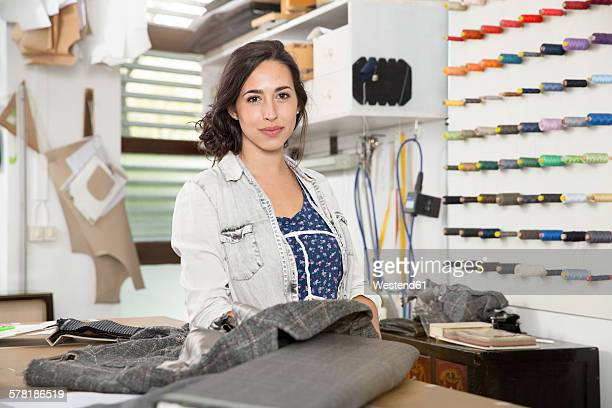 Young seamstress making a jacket