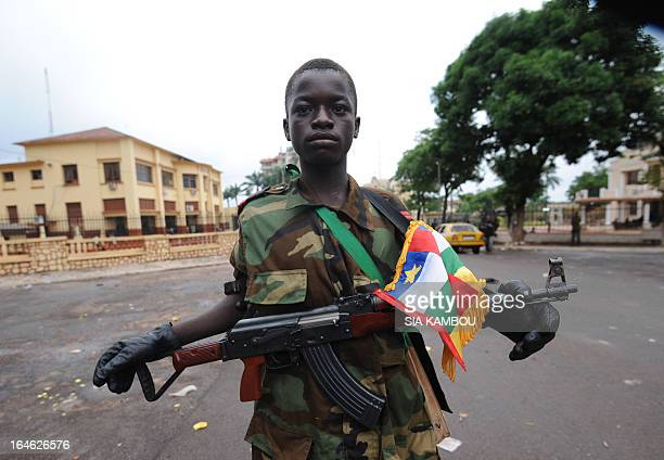 A young Seleka coalition rebel poses on March 25 2013 near the presidential palace in Bangui The UN Security Council will hold urgent talks on March...