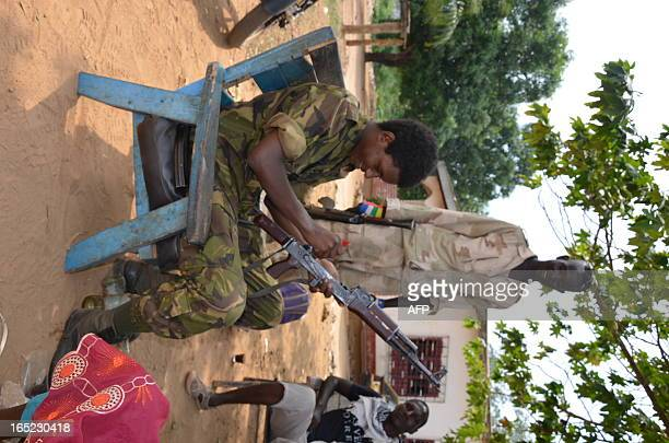 A young Seleka rebel cleans his Kalachnikov at a check point set south of Bangui on April 1 2013 The Central African Republic's new postcoup...