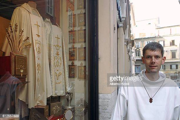 Young seminarist visits an ecclesiastical outfitters near the French Seminary in Rome.