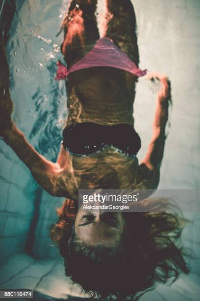 young sensual female lying in swimming pool and posing - murdered women stock pictures, royalty-free photos & images