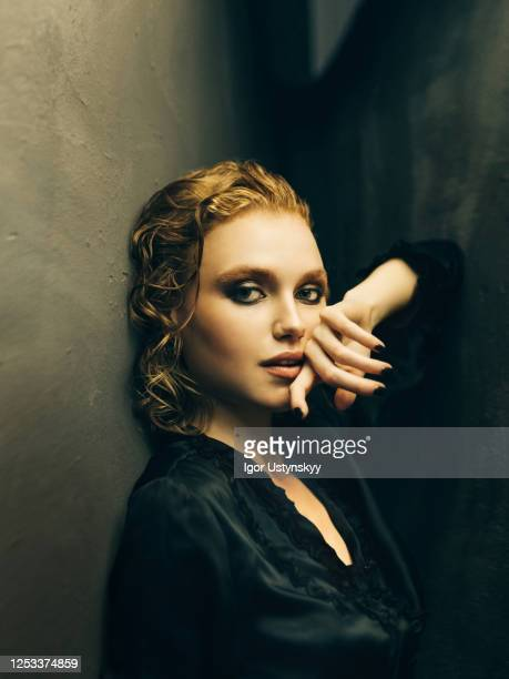 young sensual woman posing in studio - black nail polish stock pictures, royalty-free photos & images