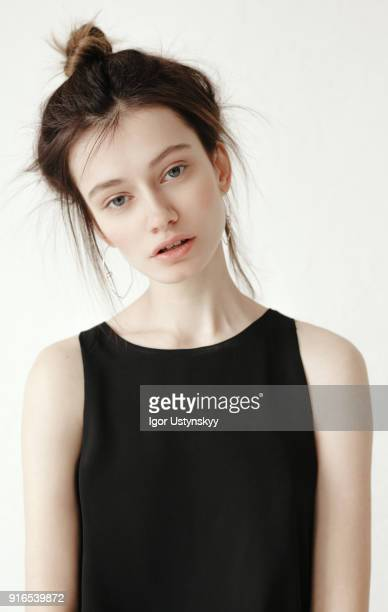 Young sensual woman standing against white background