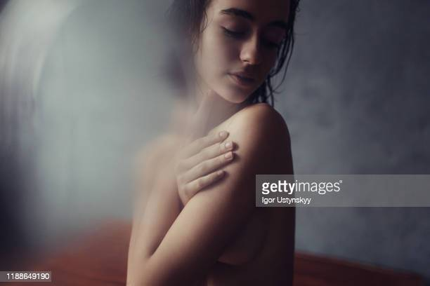 young sensual woman touching her body - halbbekleidet stock-fotos und bilder