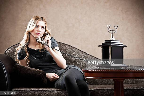 Young sensuality girl using a telephone.