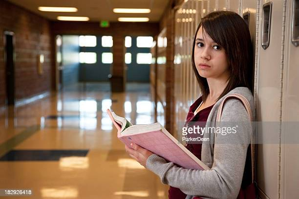 young serious girl in school hallway - cute highschool girls stock photos and pictures