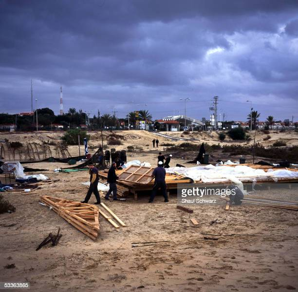 Young settlers build two wooden shacks in the dunes near the settlement of Neve Dekalim November 21 2004 in Gush Katif Gaza Strip It was the strong...