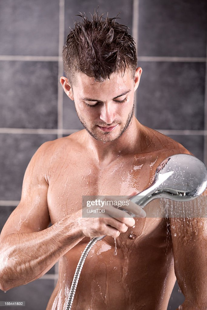 Young Sexy Man Having A Shower Stock Photo