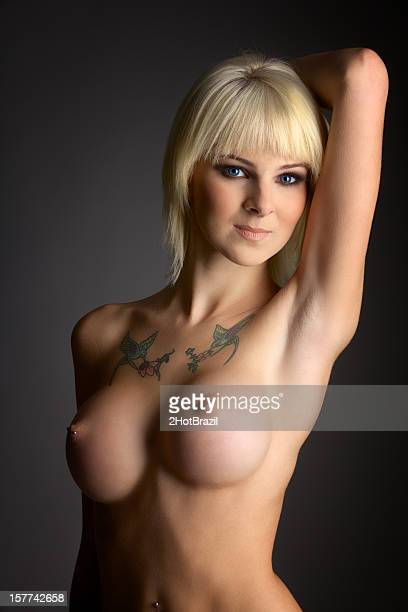 Young Sexy Topless Woman on a Dark Background