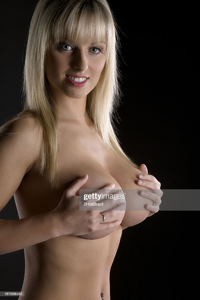 Young Sexy Topless Woman on a Dark Background : Stock Photo