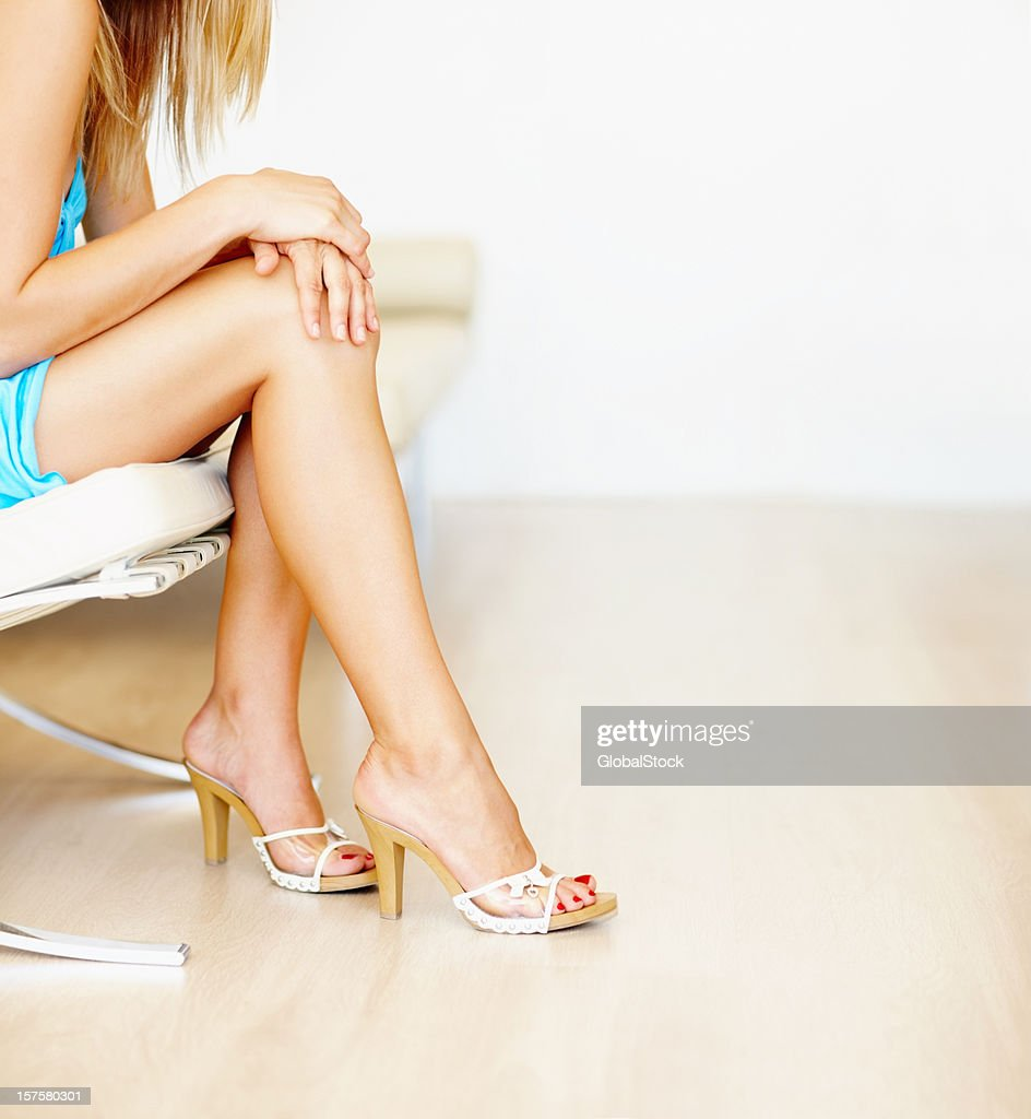 young sexy woman in high heels on a couch stock photo | getty images